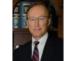 John E. Suthers image